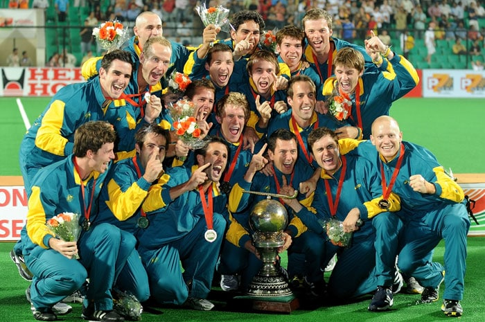 Australian hockey players pose with the trophy after winning the World Cup 2010 Final match against Germany at the Major Dhyan Chand Stadium in New Delhi on March 13, 2010. Australia won 2-1. (AFP Photo)