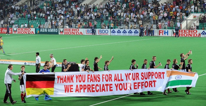 German hockey players acknowledge their supporters after the World Cup 2010 final match against Australia at the Major Dhyan Chand Stadium in New Delhi. Australia defeated Germany by 2-1 to win the final. (AFP Photo)