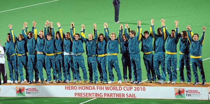Australian hockey players gesture from the winner's podium during the award ceremony after defeating Germany in the World Cup 2010 final match at the Major Dhyan Chand Stadium. (AFP Photo)
