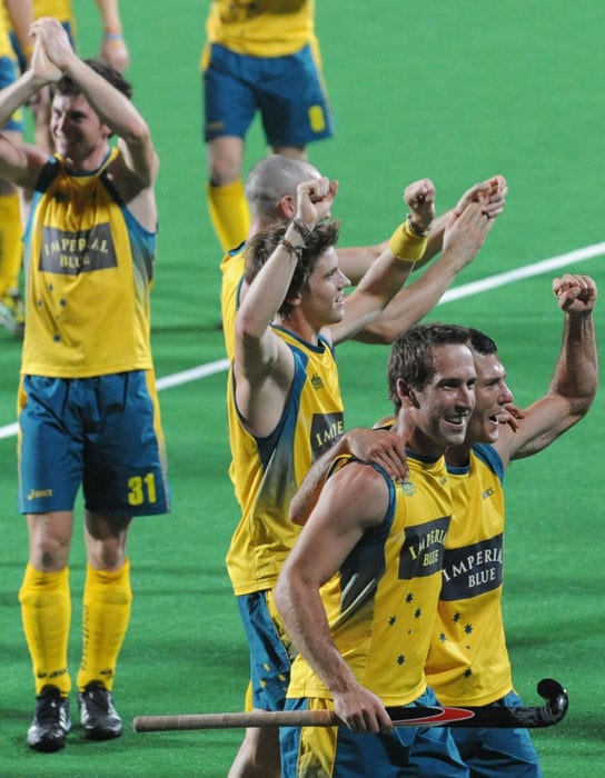 Australian hockey captain Jamie Dwyer (R) celebrates with teammates after defeating Germany during their World Cup 2010 final match at the Major Dhyan Chand Stadium. (AFP Photo)