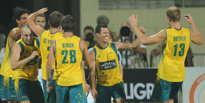 Australian hockey captain Jamie Dwyer (2nd R) celebrates with teammates after winning the World Cup 2010 Final match against Germany at the Major Dhyan Chand Stadium. (AFP Photo)