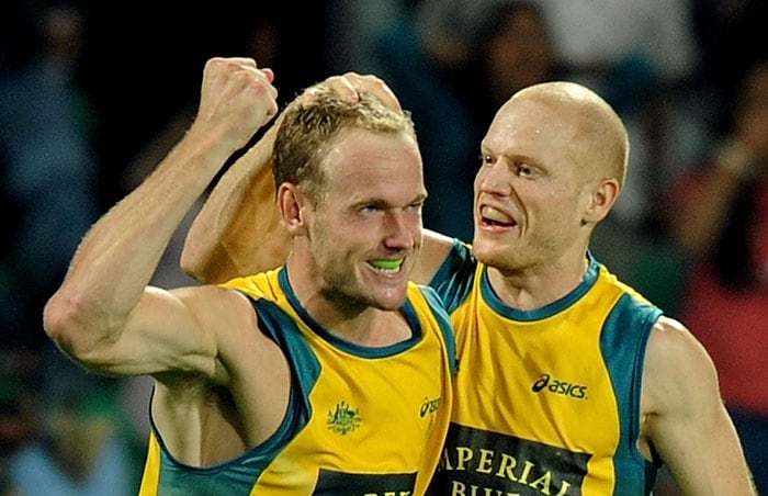 Australian Hockey player Luke Doerner (L) reacts after scoring a goal against Germany during their World Cup 2010 Final match at the Major Dhyan Chand Stadium. (AFP Photo)
