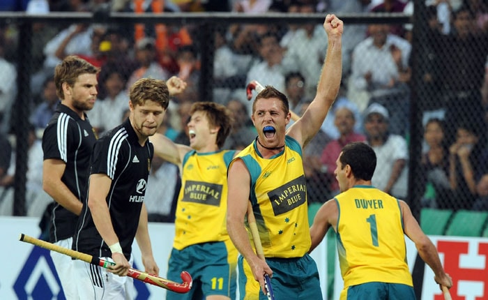 Australian hockey player Grant Schubert (2nd R) celebrates a goal against Germany with teammates Eddie Ockenden (3rd R) and Jamie Dwyer (R) during their World Cup 2010 final match. (AFP Photo)