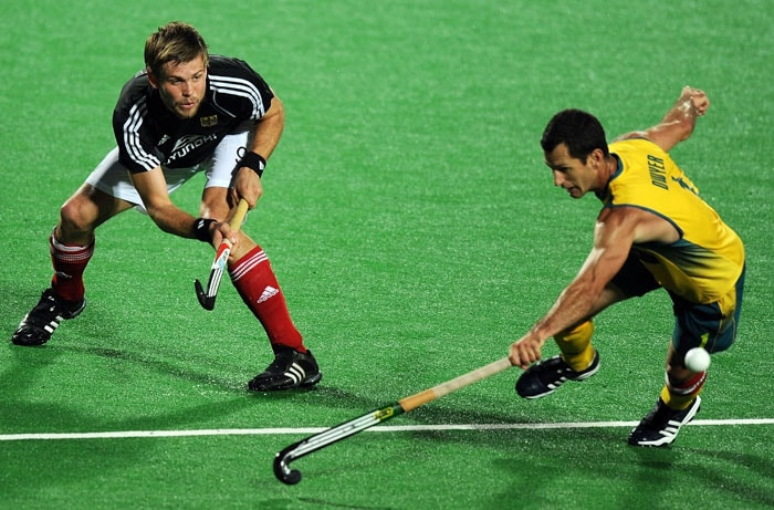 Australian hockey captain Jamie Dwyer (R) vies for the ball with Germany's Moritz Furste (L) during their World Cup 2010 Final match at the Major Dhyan Chand Stadium. (AFP Photo)