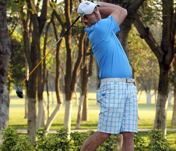 Cameron White polishes his batting skills as he clubs one at the Karnataka golf course. (Getty Images)