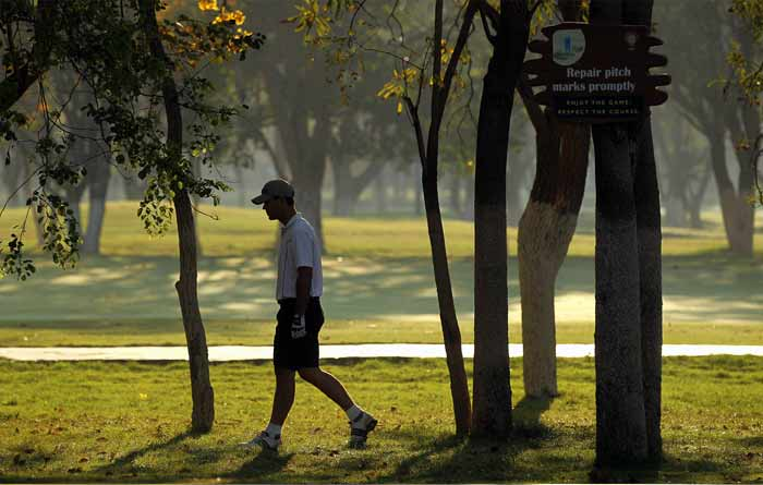 Ricky Ponting of Australia takes a stroll at the Karnataka Golf Course. (Getty Images)