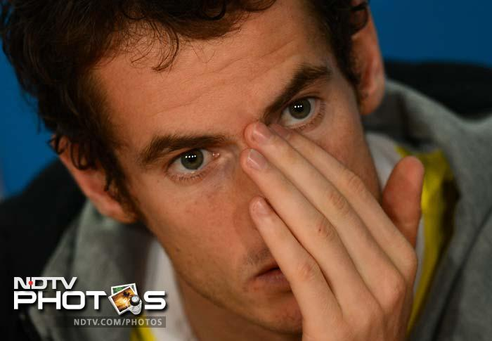 Murray answers a question during a press conference after the match.