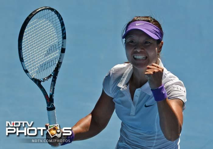 China's Li Na celebrates a point against Maria Sharapova.<br><br>Li, 30, defeated the world number two 6-2, 6-2 in 1hr 33min.