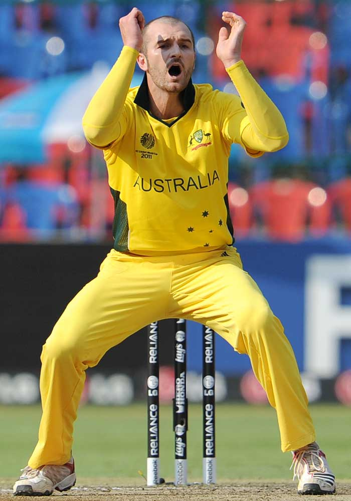 Australian spinner Jason Krejza reacts as he bowls to the Canadian batsman. (AFP Photo)