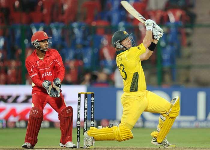 Australian batsman Shane Watson watched by Canadian wicketkeeper Ashish Bagai as he plays a shot. (AFP Photo)
