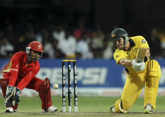 Australian batsman Shane Watson watched by Canadian wicketkeeper Ashish Bagai plays a shot during the Cricket World Cup match between Australia and Canada. (AFP Photo)