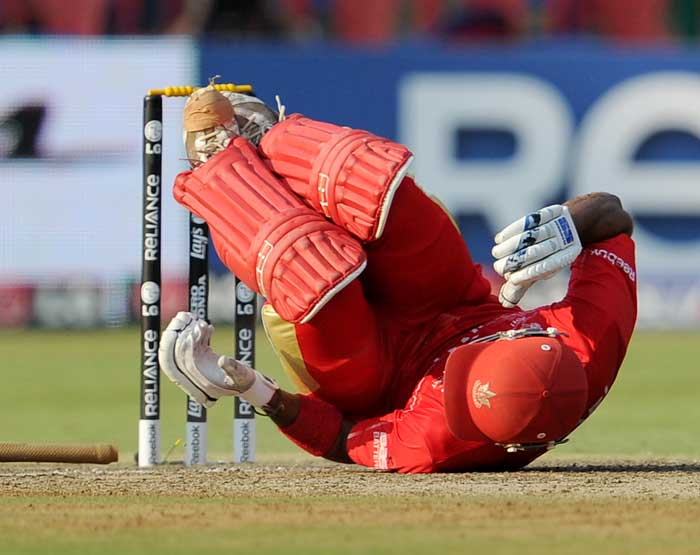 Canadian batsman Zubin Surkari collapses to the ground after been hit by a bean-ball bowled by Australian fast bowler Shaun Tait. (AFP Photo)