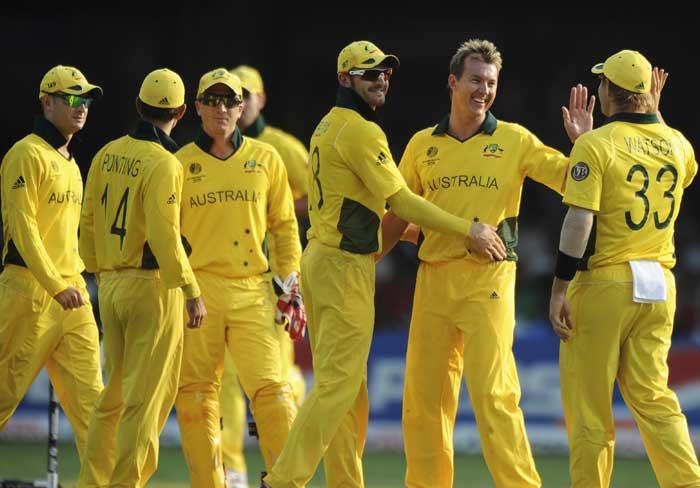 Australian fielders congratulate fast bowler Brett Lee for taking the wicket of Canadian batsman Rizwan Cheema during the Cricket World Cup match. (AFP Photo)