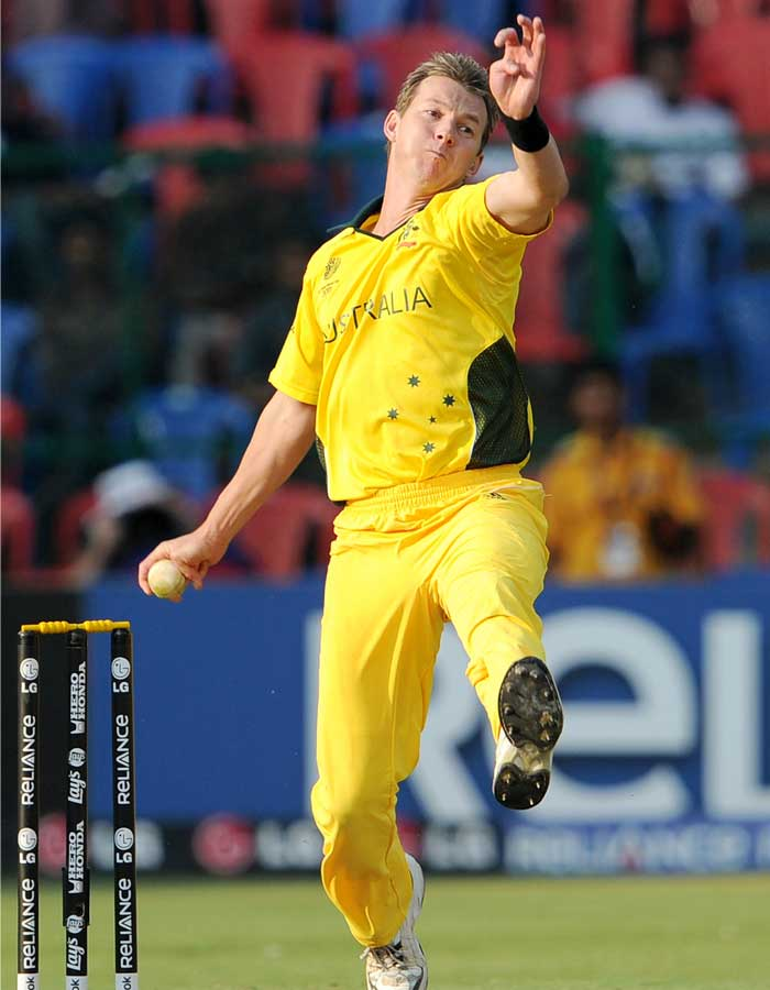 Australian fast bowler Brett Lee throws a delivery as he takes four Canadian wickets. (AFP Photo)
