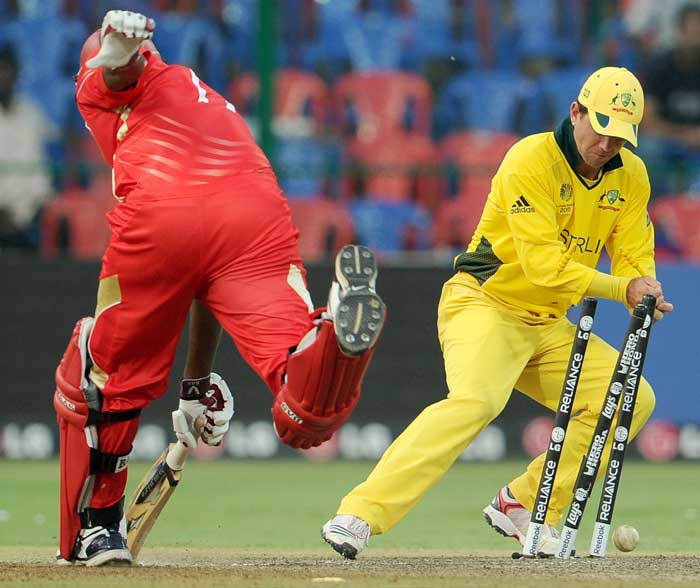 Australian captain Ricky Ponting drops the ball as he attempts to run out Canadian batsman Henry Osinde in their World Cup cricket match played at the M.Chinnaswamy Stadium. (AFP Photo)