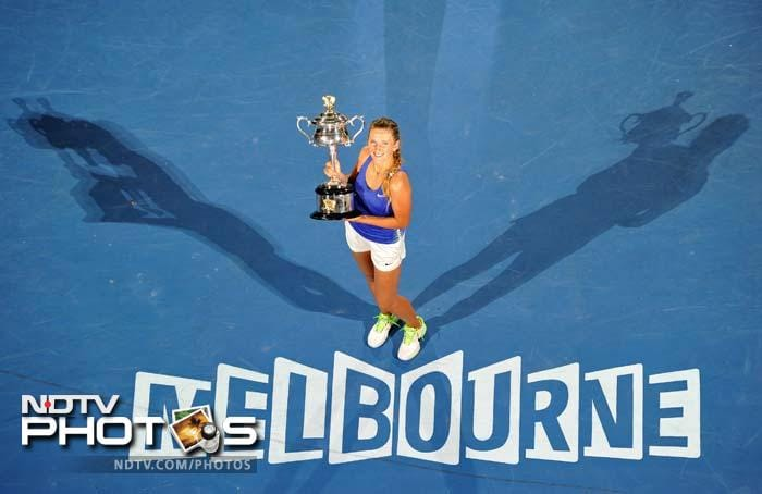 Victoria Azarenka won her first grand slam title and became the new world number one when she thrashed Maria Sharapova 6-3, 6-0 in the Australian Open final on Saturday. (All AFP and AP Images)