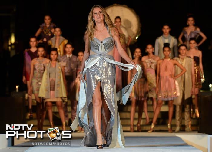 Azarenka was not shy to show off her style to the photographers on the ramp.