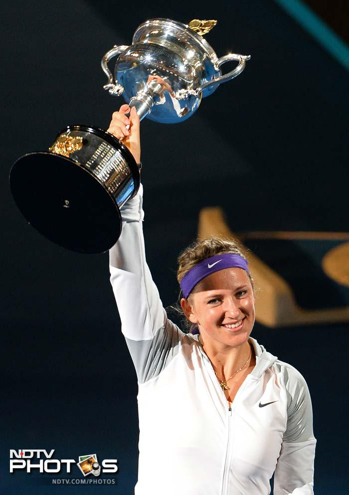 Victoria Azarenka overcome an often hostile crowd to win back-to-back Australian Open titles, beating Li Na 4-6, 6-4, 6-3 in a dramatic final on Saturday that contained a break for fireworks, two medical timeouts and a nasty fall to the court by Li. (All AFP images and text)