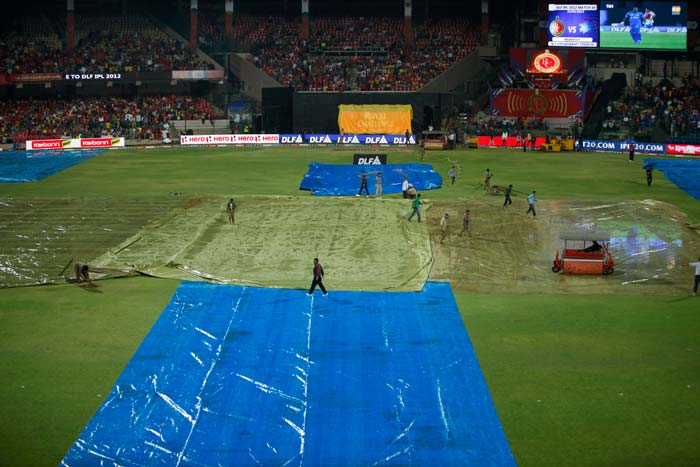Initially, the toss was delayed due to a wet outfield followed by heavy rains. It was eventually won by Bangalore's stand-in skipper Virat Kohli who opted to bowl. (AP Photo/Aijaz Rahi)