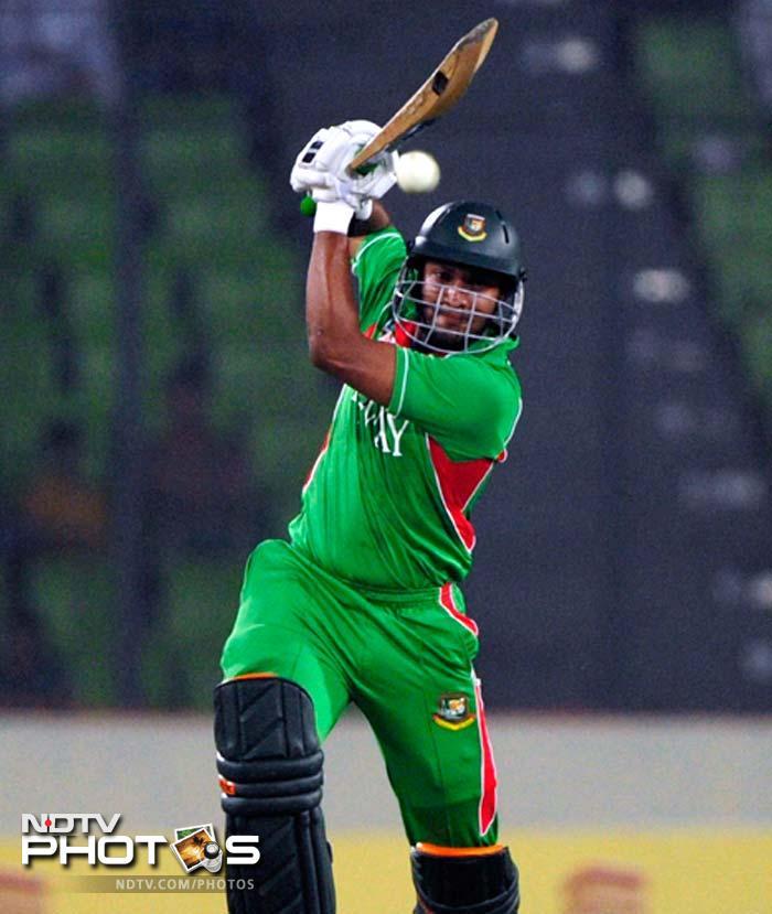 Bangladeshi batsman Shakib Al Hasan plays a shot. Shakib was dismissed for 64. (Photo: AFP)
