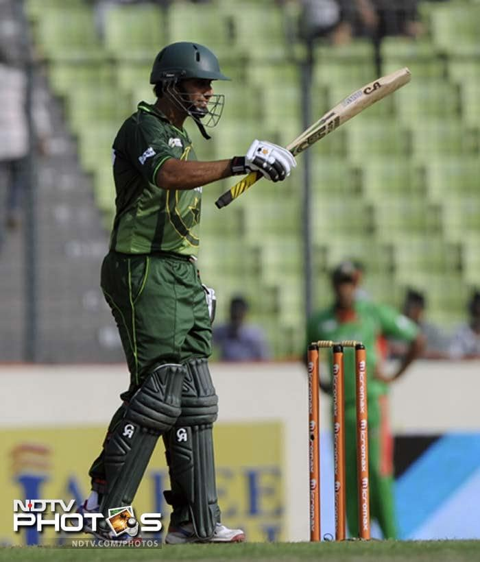 Pakistan batsman Nasir Jamshed gestures after scoring a half-century. (Photo: AFP)