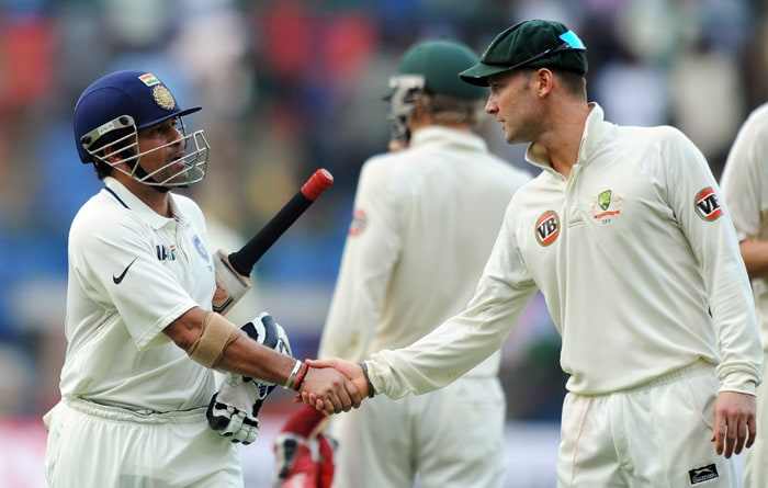 Australian cricketer Michael Clarke (R) congratulates Indian cricketer Sachin Tendulkar for becoming the first ever batsman to reach the milestone of 14,000 Test runs during the second day of the second Test between India and Australia at M.Chinnaswamy Stadium in Bangalore. (AFP PHOTO)