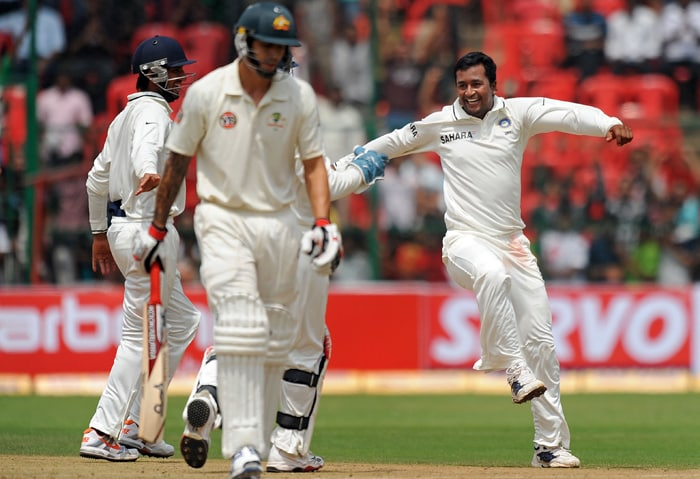 India's Pragyan Ojha (R) celebrates the wicket of Australian cricketer Mitchell Johnson (front L) during the second day of the second Test between India and Australia at M. Chinnaswamy Stadium in Bangalore. (AFP PHOTO)