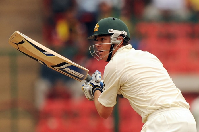 Australian cricketer Marcus North plays a shot during the second day of the second test between India and Australia at M.Chinnaswamy Stadium in Bangalore. (AFP PHOTO)