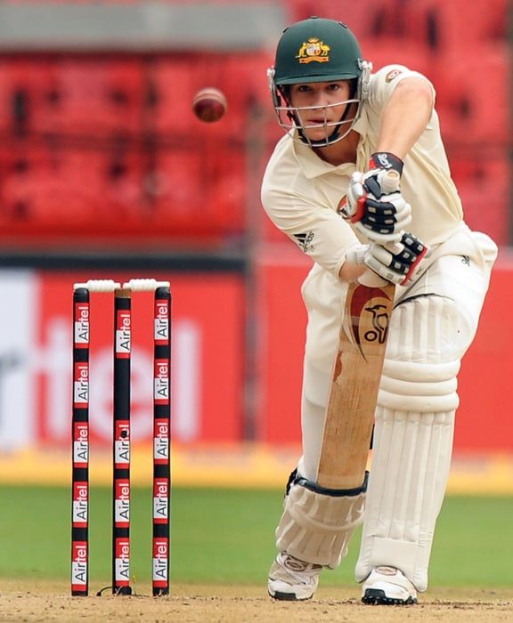 Australian cricketer Tim Paine plays a shot during the second day of the second test between India and Australia at M.Chinnaswamy Stadium in Bangalore. (AFP PHOTO)