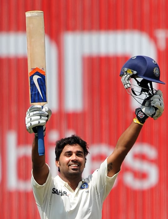 India's Murli Vijay celebrates his century during the third day of the second Test between India and Australia at M. Chinnaswamy Stadium in Bangalore. (AFP Photo)