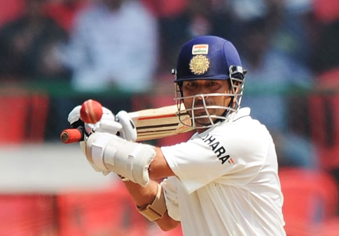 Indian cricketer Sachin Tendulkar plays a shot during the third day of the second Test between India and Australia at M. Chinnaswamy Stadium in Bangalore. (AFP Photo)