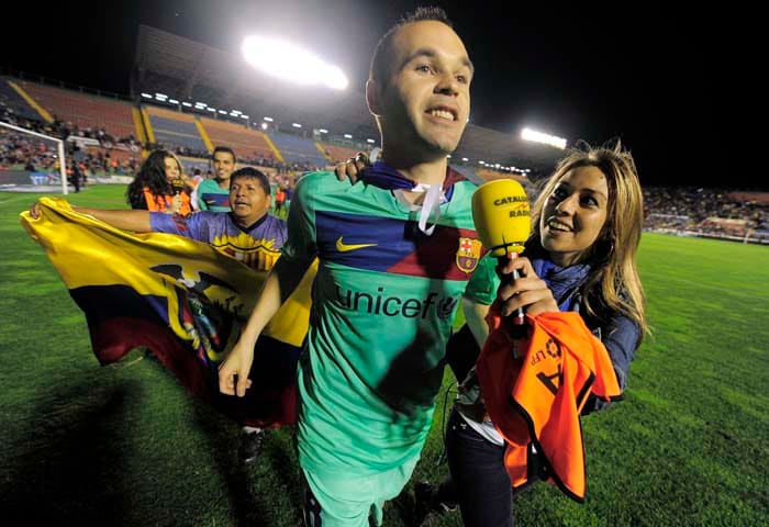 Barcelona midfielder Andres Iniesta is hounded by the press after the team was crowned Spanish champions for the third successive season with a 1-1 draw at Levante, clinching a 21st domestic title with two games to spare. (AFP PHOTO)