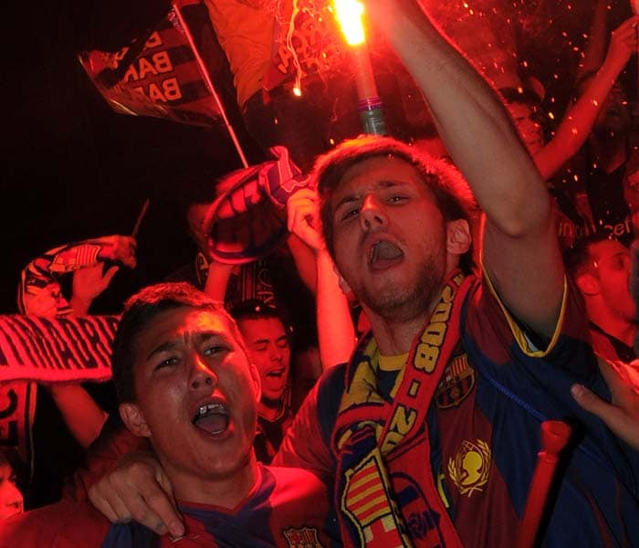 Barcelona supporters are jubilant after their team clinched its 3rd straight La Liga title with a 1-1 draw at Levante, taking their domestic league championship wins to 21. (AP Photo)