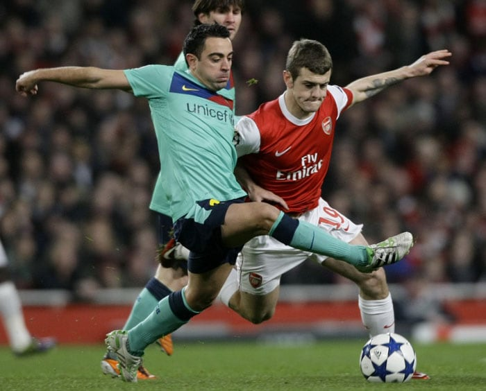 First Knockout Round: Advanced past Arsenal (England) 4-3 on aggregate<br><br> Barcelona dominated Arsenal in London for a second straight season but failed to add to David Villa's first-half opener and conceded two goals in the last 12 minutes for a surprising 2-1 loss in the first leg. Arsenal were in a position to advance when the second leg was 1-1 with 20 minutes left, but Xavi Hernandez scored his first Champions League goal of the season and Lionel Messi hit his second of the game with a penalty. Javier Mascherano's covering tackle late on denied Arsenal substitute Nicklas Bendtner a goal that would have put Arsenal through but an average of almost two-thirds possession over two matches showed that Barcelona were the much stronger side.