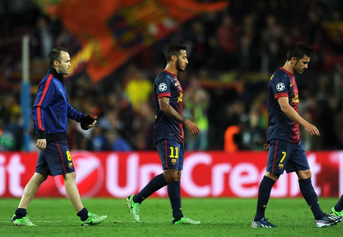 (L-R) Barcelona's midfielders Andres Iniesta and Thiago Alcantara along with forward David Villa react after suffering a 3-0 defeat against Bayern Munich at Camp Nou on Wednesday.