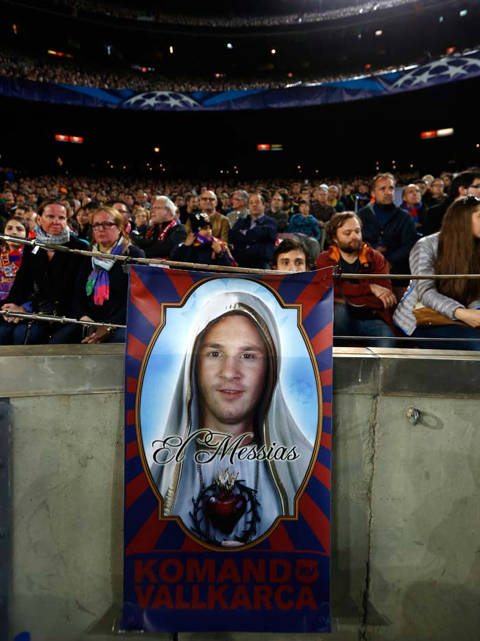 The fans of Barcelona knew the going will be tough against Bayern Munich but if anyone could save Barcelona from a rout was Lionel Messi, who was listed out of stating XI due to hamstring injury. Here is the fans' tribute to Messi - a poster depicting Lionel Messi as the Messiah at the Camp Nou.