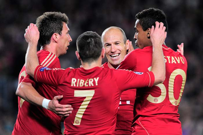 Bayern Munich's Croatian striker Mario Mandzukic, French midfielder Franck Ribery, Dutch midfielder Arjen Robben and Brazilian midfielder Luiz Gustavo celebrate after the first goal of the game was netted by Robben in the 48th minute.