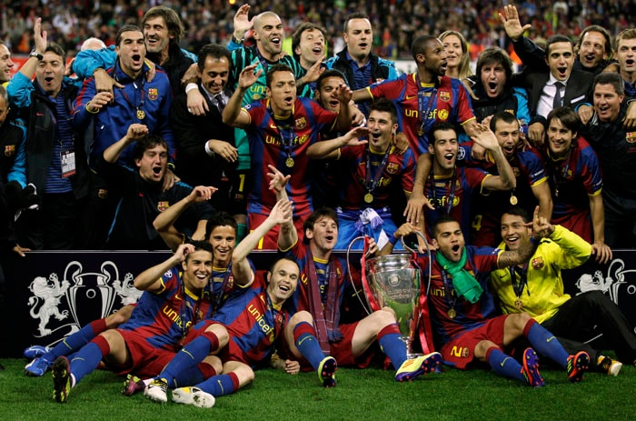Barcelona team celebrates with the trophy after winning the Champions League final against Manchester United at the Wembley Stadium. Barcelona won 3-1. (AP Photo)