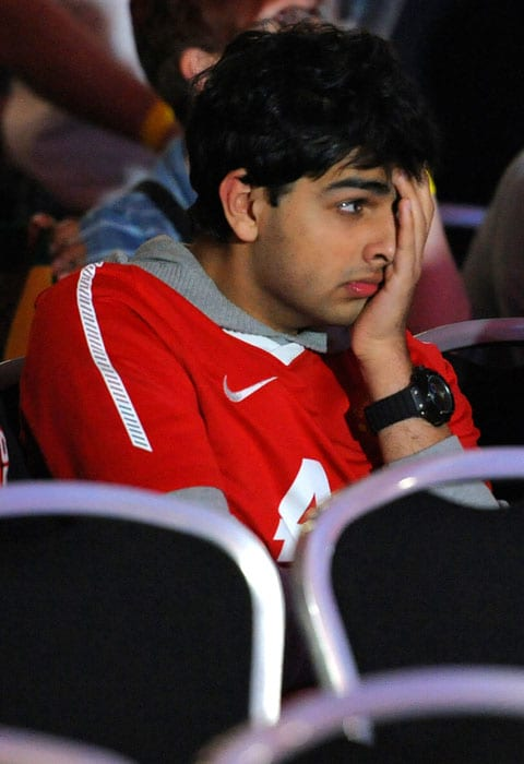 A Manchester United supporter reacts after Barcelona scored a second goal as he watches the UEFA Champions League final between Barcelona and Manchester United on a big screen at Old Trafford Cricket Ground in Manchester. (AFP PHOTO)