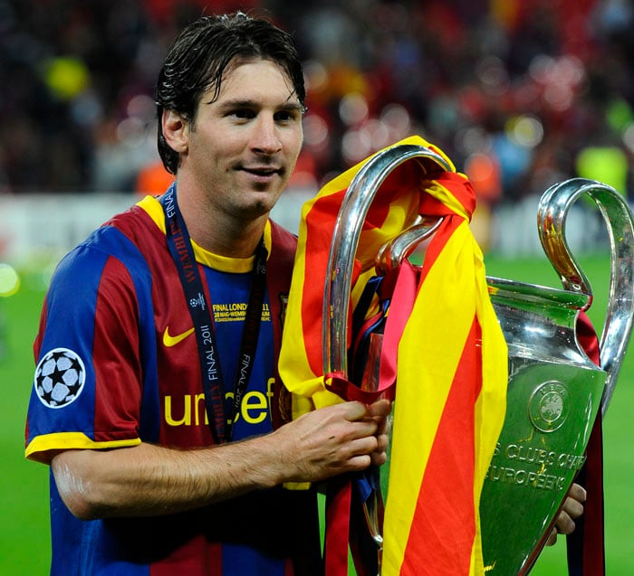 Barcelona's Argentinian forward Lionel Messi, a key architect of the victory, celebrates with the trophy at the end of the UEFA Champions League final between Barcelona and Manchester United at the Wembley stadium in London. (AFP PHOTO)