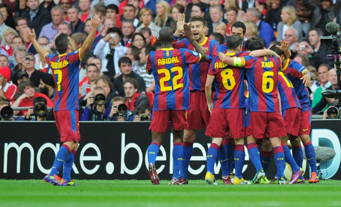 Barcelona's Spanish forward Pedro Rodriguez is congratulated by his teammates after scoring a goal during the UEFA Champions League final against Manchester United at the Wembley stadium in London. (AFP PHOTO)