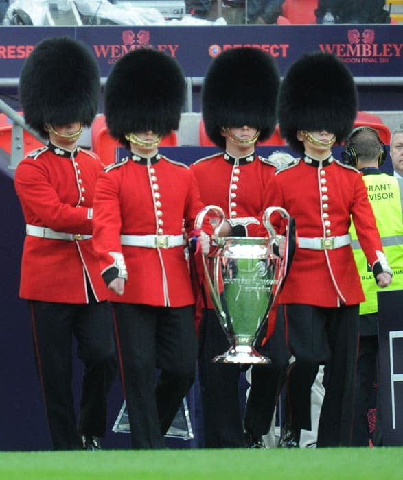 The Champions league trophy is carried by Scot guards prior to the UEFA Champions League final between Barcelona and Manchester United at the Wembley stadium in London. (AFP PHOTO)