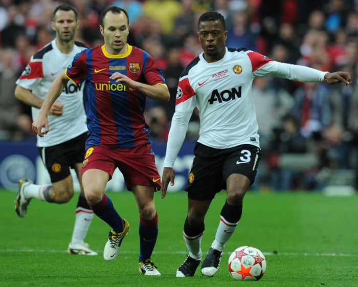 Manchester United's French defender Patrice Evra (R) vies with Barcelona's Spanish midfielder Andres Iniesta during the UEFA Champions League final at the Wembley stadium in London. (AFP Photo)