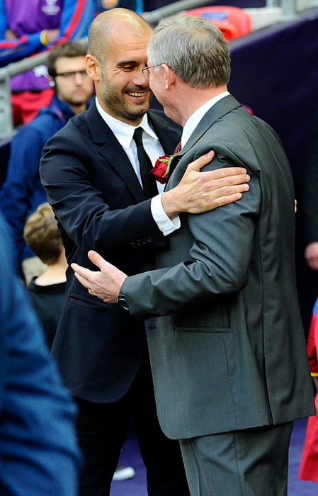 Barcelona's Spanish coach Josep Guardiola (L) embraces Manchester United manager Alex Ferguson during the UEFA Champions League final between Barcelona and Manchester United at the Wembley stadium in London. (AFP PHOTO)