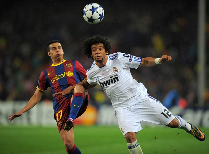 Barcelona's forward Pedro Rodriguez vies with Real Madrid's Brazilian defender Marcelo. (AFP Photo)