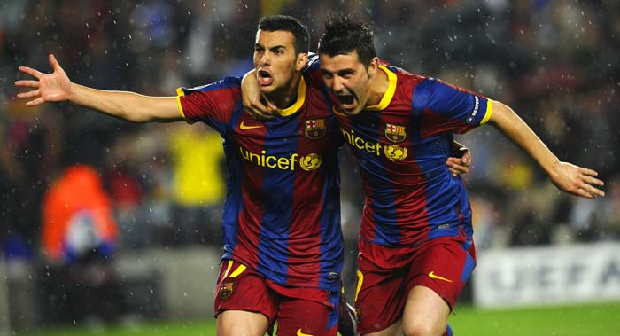 Barcelona's forward Pedro Rodriguez celebrates with teammate David Villa after scoring a goal against archrivals Real Madrid. (AFP Photo)