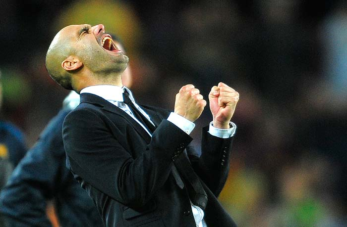 Barcelona's coach Josep Guardiola is ecstatic after his side finished on the winning side of the Champions League semi final. (AP Photo)