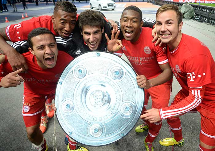Record-breaking F.C. Bayern Munich claimed their 24th German league title on Tuesday with a 3-1 win at Hertha Berlin as Pep Guardiola's side secured the title with seven games remaining. (All images from AFP)