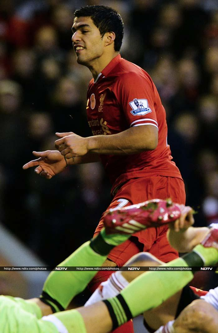 Luis Suarez scored two goals as a rampant Liverpool thrashed a hapless Fulham 4-0 at Anfield. Liverpool for the title?
