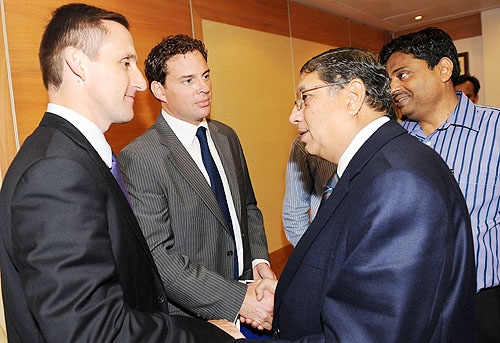 ICC Media and Communications manager Brian Murgatroyd and legal head Ian Higgins greet BCCI officials N. Srinivasan and Ratnakar Shetty after an emergency session to discuss the Indian cricketers' refusal to sign the clause with World Anti-Doping Agency (WADA), in Mumbai on August 2, 2009. India's cricket chiefs have backed the country's top stars who refused to sign an anti-doping code, raising fears of a stand-off with the sport's world governing body. The decision-making working committee of the BCCI met in an emergency session in the western Indian city to discuss the players' refusal to sign the WADA code because they said it infringed their privacy. India's top players are the only ones in world cricket who had not signed the WADA documents by the August 1 deadline set by the ICC. (AFP Photo)